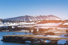 Myvatn volcano with snow cover Iceland stock photos