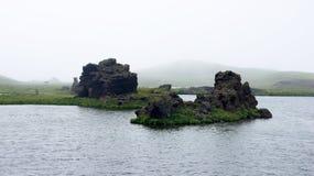 Myvattn Hofdi area in the mist. Colourfull volcanic rocks in the mist at the Hofdi peninsula of Myvatn lake stock photo