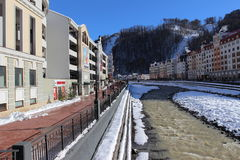 The Mzymta river and hotels  in the village of Rosa Khutor. Stock Image