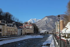 The Mzymta river and hotels  in the village of Rosa Khutor. Royalty Free Stock Photos