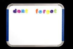 Não esqueça na placa magnética Fotos de Stock