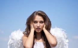 Não ouça nenhuns mal, menina do anjo e céu Foto de Stock Royalty Free