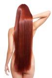 Näck kvinna med långt rött hår Arkivfoton