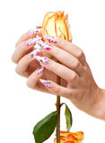 Nägel und Blume Stockfotos