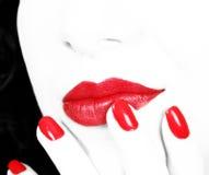 Nägel und Lippen Stockbild