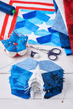 Nähen der Steppdecke mit stilisierten Elementen der amerikanischer Flagge Stockfoto