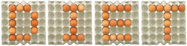 NÄHREN Sie Wort von den Eiern im Papierbehälter im Papierbehälter stockfotografie