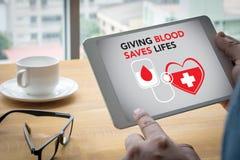 När DU GER BLOD SPARAR LIFES-bloddonation ger liv Royaltyfri Bild
