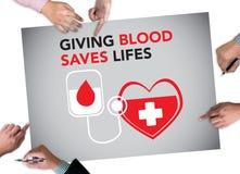 När DU GER BLOD SPARAR LIFES-bloddonation ger liv Arkivbild