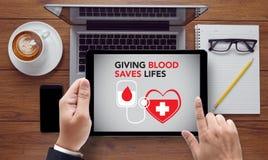 När DU GER BLOD SPARAR LIFES-bloddonation ger liv Royaltyfria Bilder