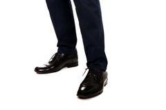Närbild av affärsmanfot i svarta kängor Royaltyfri Bild