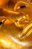 Närbild av att vila Buddhastatyn i den Wat Pho templet Bangkok, Thailand Royaltyfria Foton