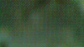 Närbild av bildskärmens PIXEL Rgb-PIXEL på TV:N stock video