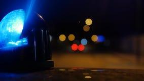 Närbild av blinkande ljus på en polisbil 4k stock video