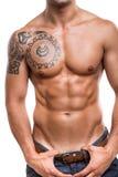 Närbild av de buk- musklerna Arkivbild
