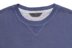 Närbild av den blåa utslagsplats-skjortan arkivfoton