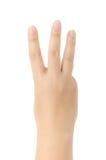 Närbild av den kvinnliga handen som gör en gest, medan isolerat på vit Arkivfoton