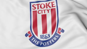 Närbild av den vinkande flaggan med logoen för Stoke City fotbollklubba, tolkning 3D Royaltyfri Illustrationer