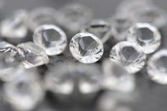 Närbild av en diamant bland många Royaltyfri Fotografi