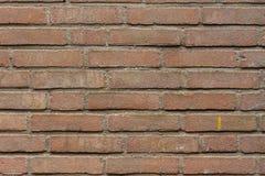 Närbild av en röd och brun tegelstenvägg Royaltyfria Foton