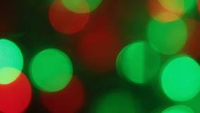 Närbild av ett långsamt fladdrande av kulöra ljus arkivfilmer