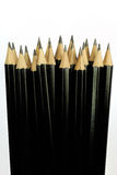 Närbild av flera svarta blyertspennor royaltyfri fotografi