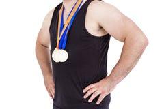Närbild av idrottsman nen med den olympic medaljen Fotografering för Bildbyråer