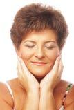 Närbild av moget le för kvinna Arkivbilder