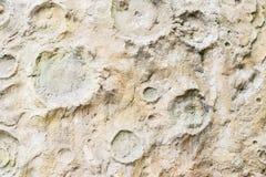 Närbild av rgrungetextur av betongväggen som är liknande till yttersidamånen För modern bakgrund modell, tapet eller Arkivbilder