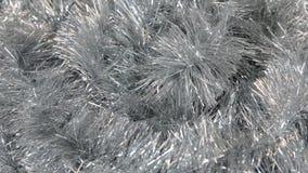 Närbild av rotationen av silverglitter Jul bakgrund, glitter arkivfilmer