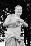 Närbild av statyn av den roman guden Fauno royaltyfria bilder
