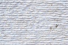 Närbild av stenyttersida med spår av att bearbeta Parallellen fodrar på stenen som lämnas av det bitande hjälpmedlet Abstrakt beg Arkivfoto