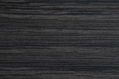 Närbild av träbakgrund svart ebenholtssvart dyrt högt res-texturträ Royaltyfri Fotografi