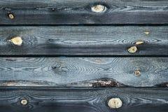 Närbild för bakgrundsträtextur av gamla bräden med sprickor royaltyfri fotografi