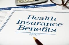 Närbild för bok för sjukförsäkringfördelar Royaltyfri Foto
