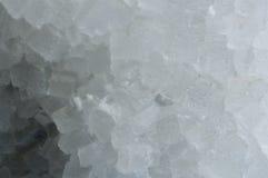 Närbild på ett kvarter av salt Arkivfoton