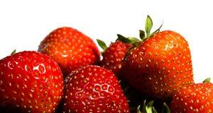 Närbild på jordgubbar som isoleras på vit bakgrund royaltyfria bilder