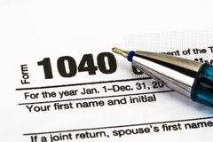 Närbild U S inkomstskatt för 1040 datalista Fotografering för Bildbyråer