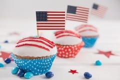 Närbilden av muffin dekorerade med 4th det juli temat Arkivfoton