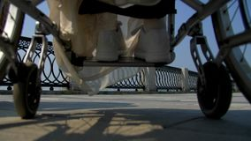 Närbildhjul på en rullstol stock video