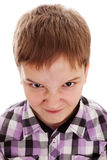 Mycket ilsken tonårs- pojke royaltyfri foto