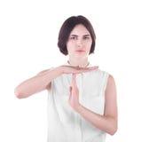 Närbildståenden av en visningtid för ung kvinna ut gör en gest, isolerat på en vit bakgrund Positiva och negativa sinnesrörelser Arkivfoto