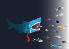 Näringsliv: Den stora fisken äter den lilla fisken Arkivbild