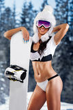 Nästa snowboard för attraktiv flicka Arkivfoton