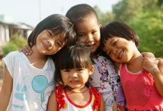 Nätt älskvärd framsida, asiatiska barn Arkivbild