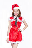 Nätt asiatisk flicka i jultomtendräkten för jul på vit backgr Royaltyfri Bild