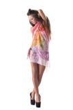 Nätt barnmodell som poserar i färgrika saronger Fotografering för Bildbyråer