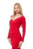 Nätt blond dam i den röda klänningen som isoleras på Royaltyfri Foto