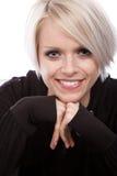 Nätt blond kvinna med ett stråla leende royaltyfria bilder