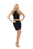 Nätt flicka i den svarta mini- klänningen som isoleras på vit Arkivfoton